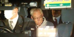Greg Kelly, ancien collaborateur de Carlos Ghosn chez Nissan, est vu dans une voiture, après avoir été libéré d'un centre de détention à Tokyo, au Japon, le 25 décembre 2018.